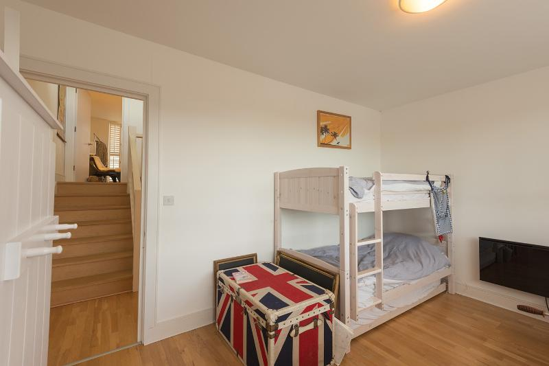 Kids bedroom with bunk bed for 3 and separate junior bed.