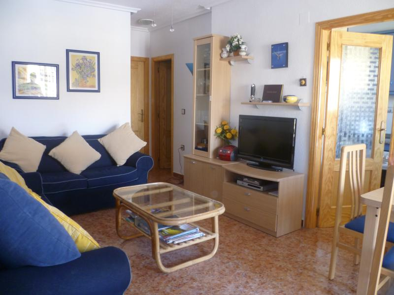 lounge with 2 sofas & extending table & 4 chairs,tv. Door leading into Kitchen on the right