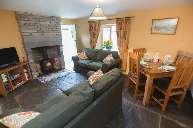 Cosy sitting room with wood burner for winter breaks