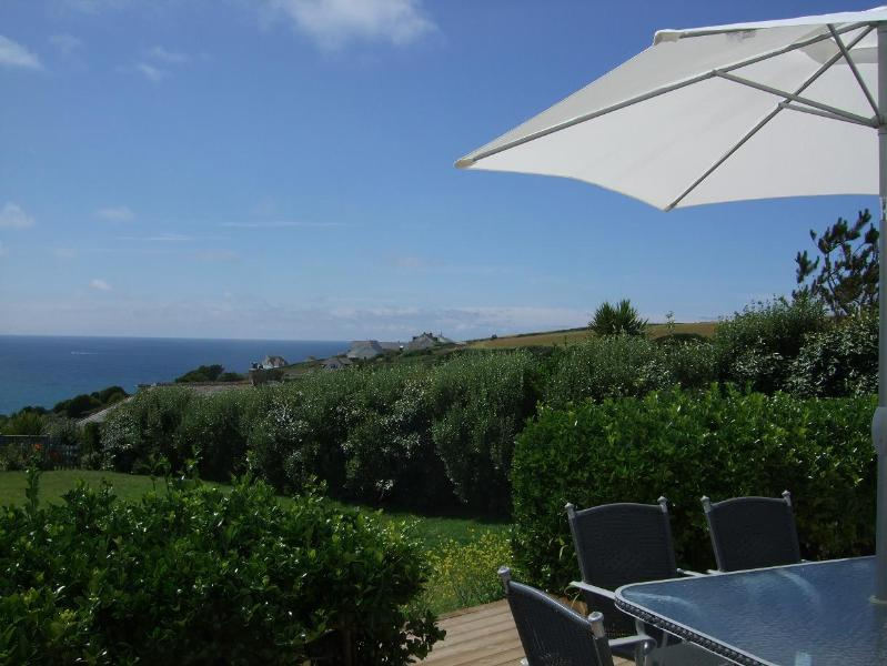 Relaxing under a parasol - enjoying summer sunshine and sea views