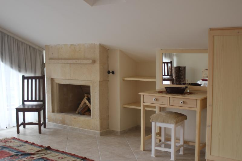 Upstairs fireplace and dressing table in master bedroom