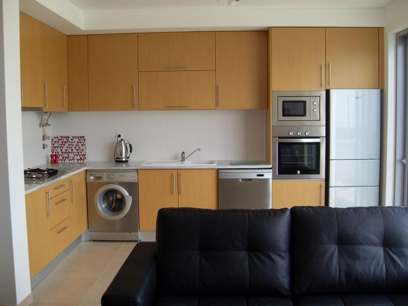 Another View of Kitchen including Fridge freezer, toaster and kettle