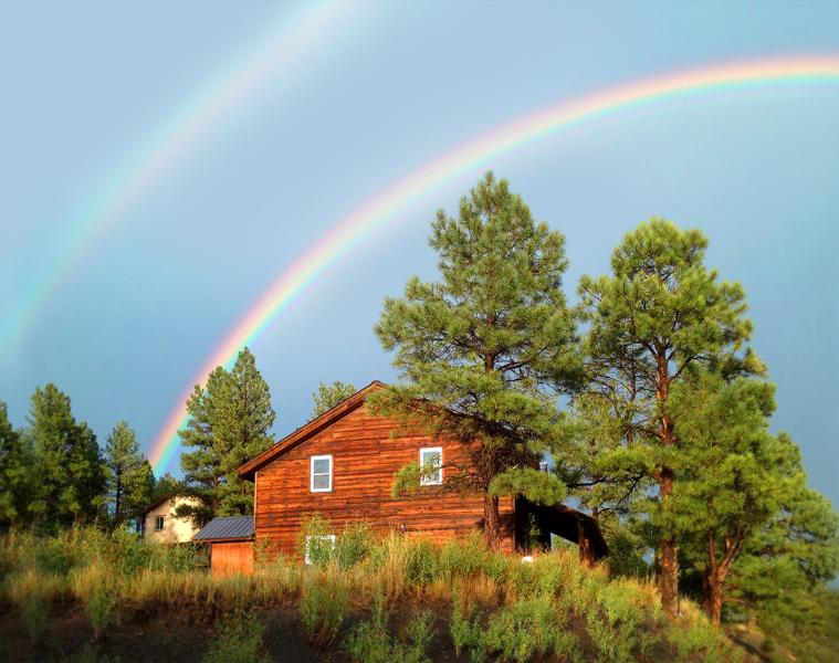 Summertime rainbows over Split Pine Cabin