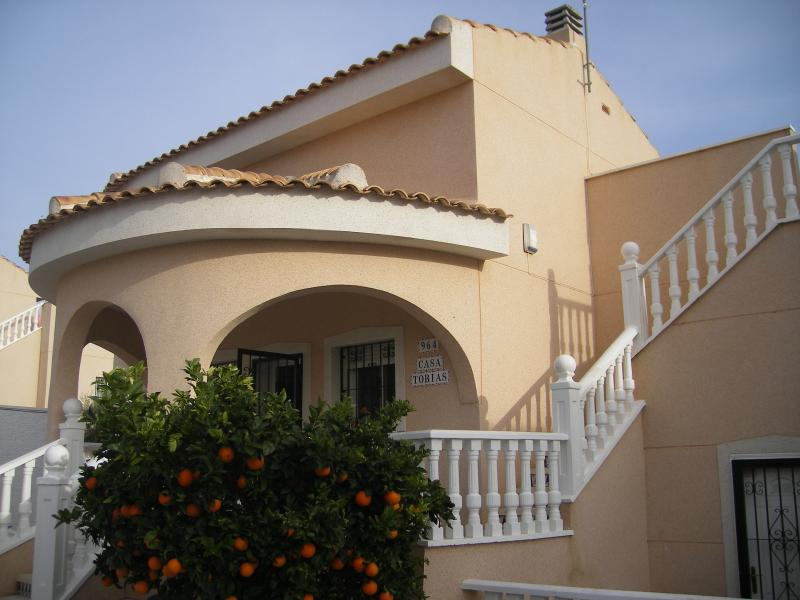The Villa with stairs to the secluded roof solarium and fresh oranges if you are there in the winter