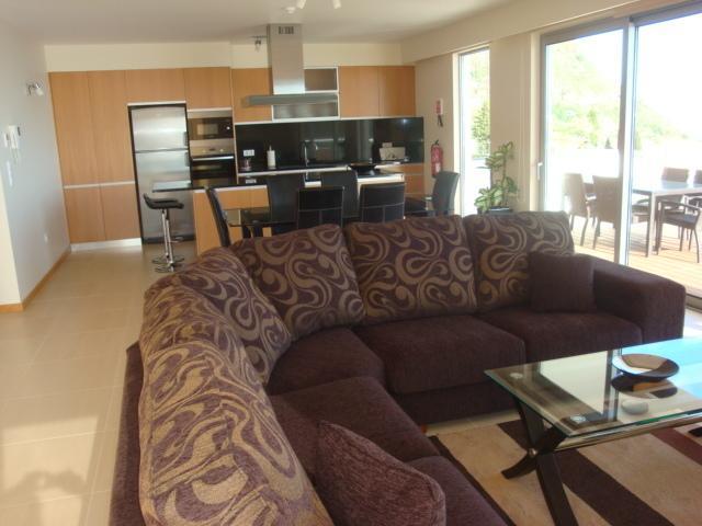 Open plan lounge/dining/kitchen area