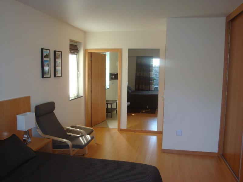 Bedroom 1 with entrance to ensuite bathroom