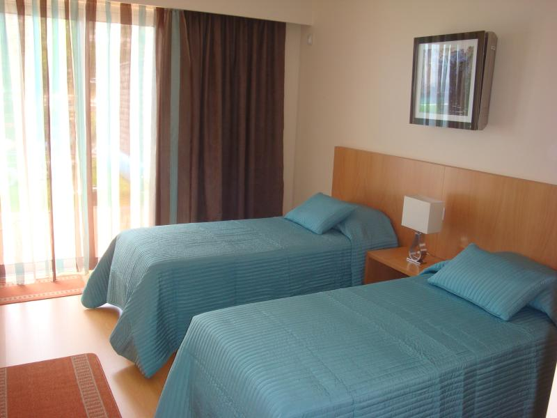 Bedroom 2, with direct access to pool area