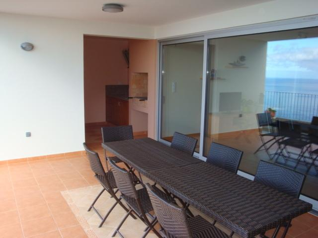 Covered terrace and barbecue area on lower level