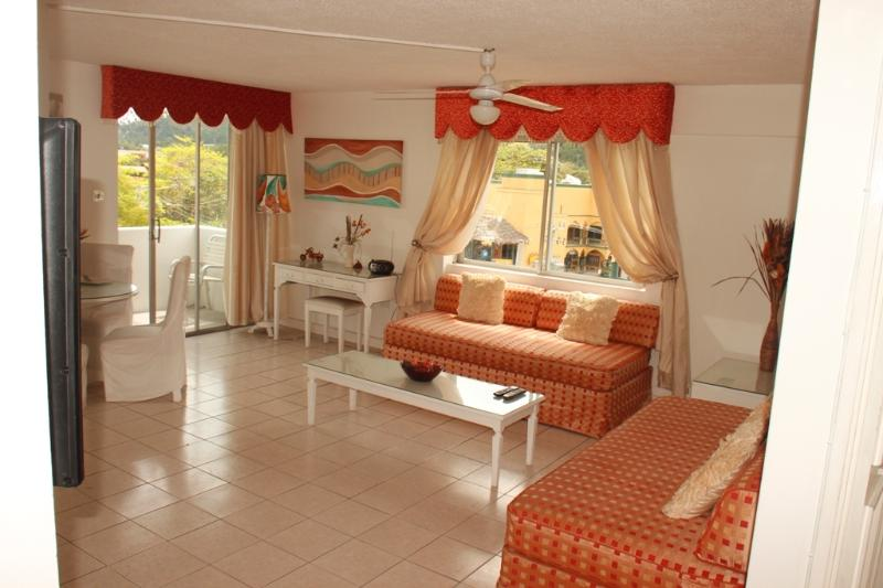 Deluxe one bedroom ...Spacious lounge leading to balacony