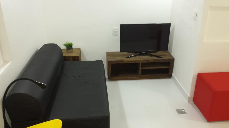 Living room with a sofa bed - Sala de estar com sofa cama