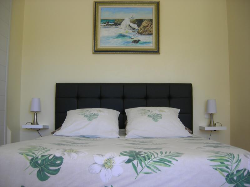 Main room with double bed and large wardrobe closets