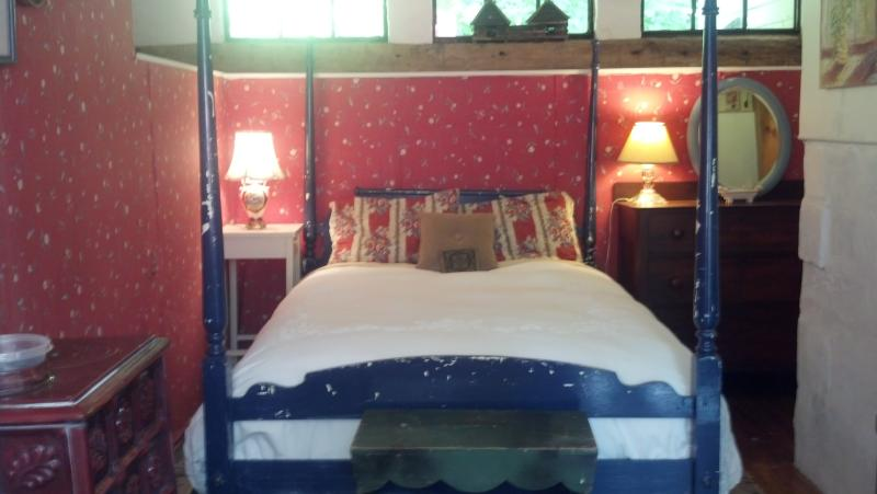 there are garden views from your four poster double bed. everything is quietly floral.