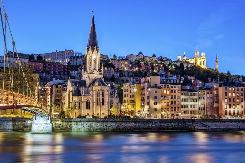 Voici votre logement, l'un des immeubles les plus photographiés de Lyon !