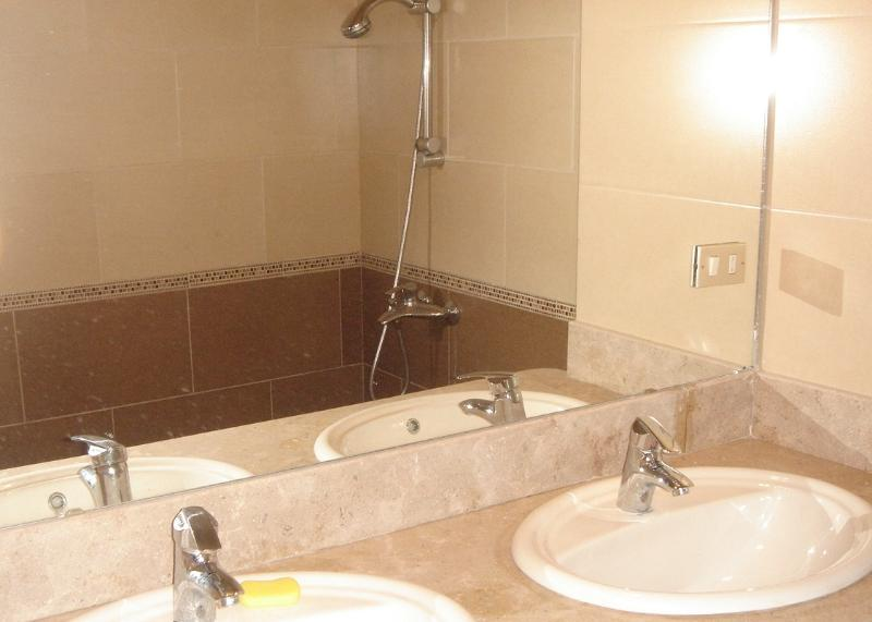 bathroom with two sink, shower and toilet