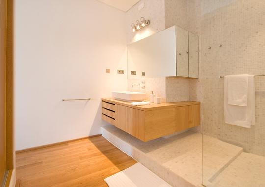 spacious marble and hoakwood bathroom with extra large shower