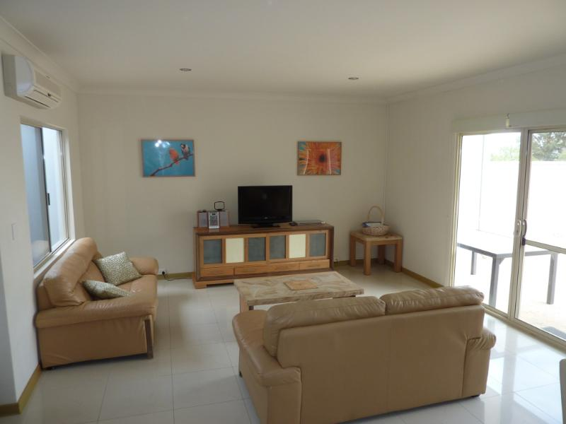 Lounge with LCD TV, DVD player and CD stereo