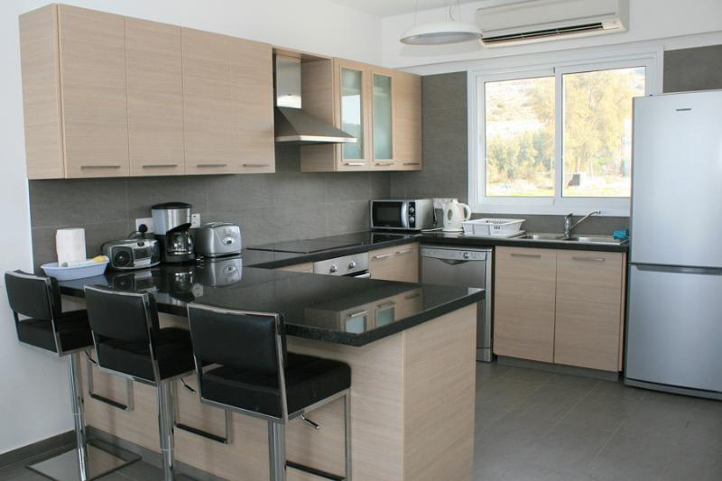 Breakfast bar, and, Kitchen equipped with all modern amenities