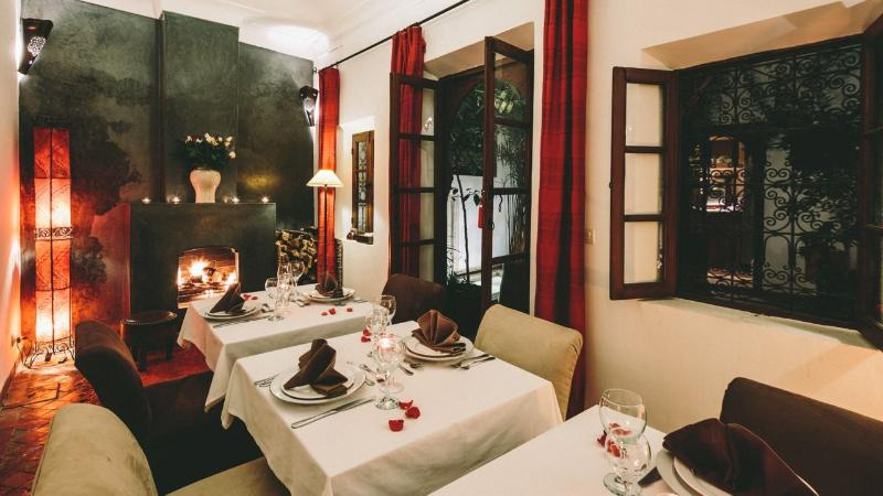 Dining by the log fire at Dar Zaman