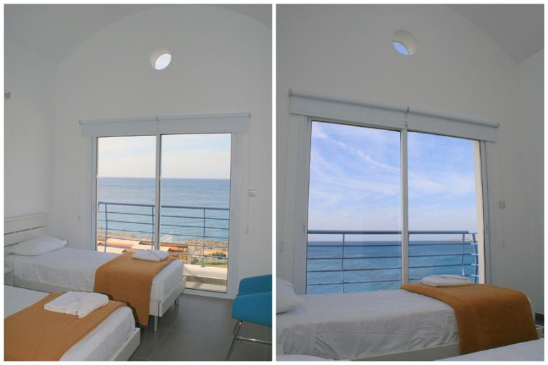 Upper level twin bedroom 'C' with high domed roof and amazing sea views