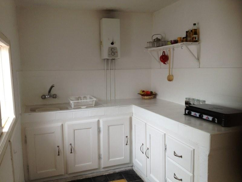 kitchen (contains among other things a water heater, gas plates, a fridge and a sink)