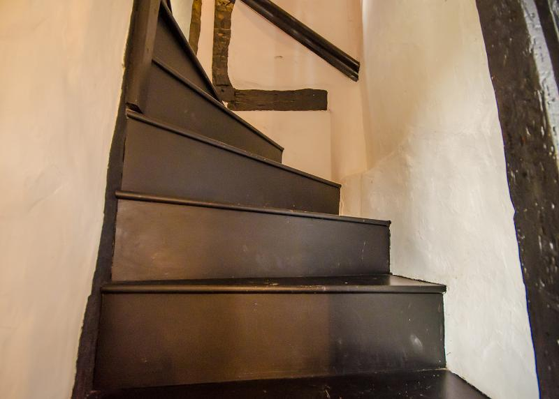 Stair case ,typical Suffolk cottage style winding up to the bedrooms