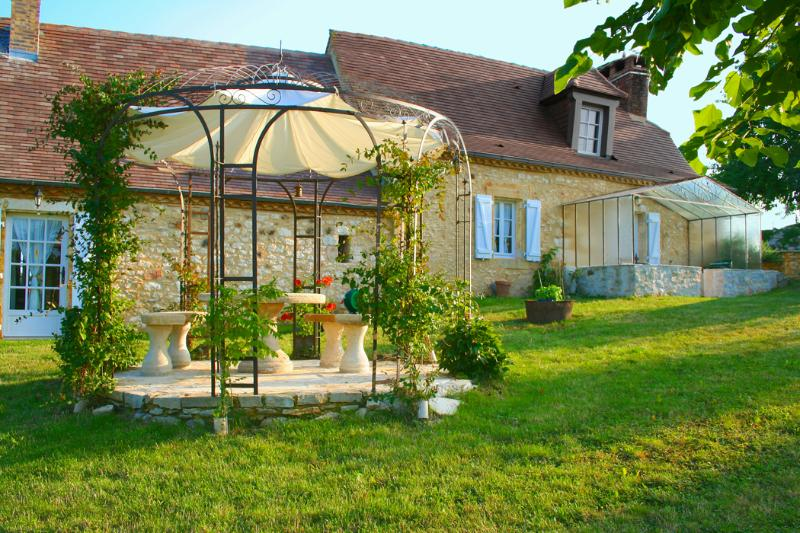 Typical House of the Périgord built with stones in 1872 with its Véranda and its Pergola