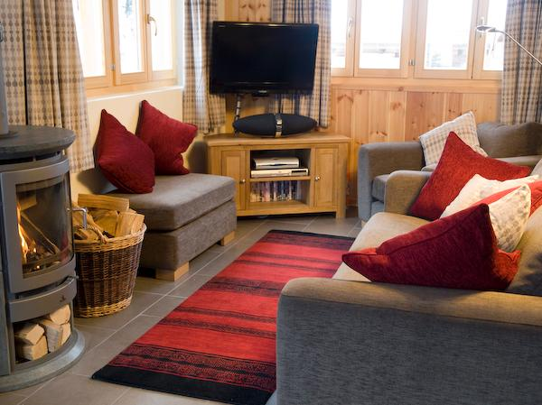 Sitting room with comfy sofas, fire and TV