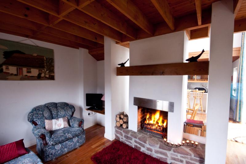 Sitting Room with roaring open turf fire
