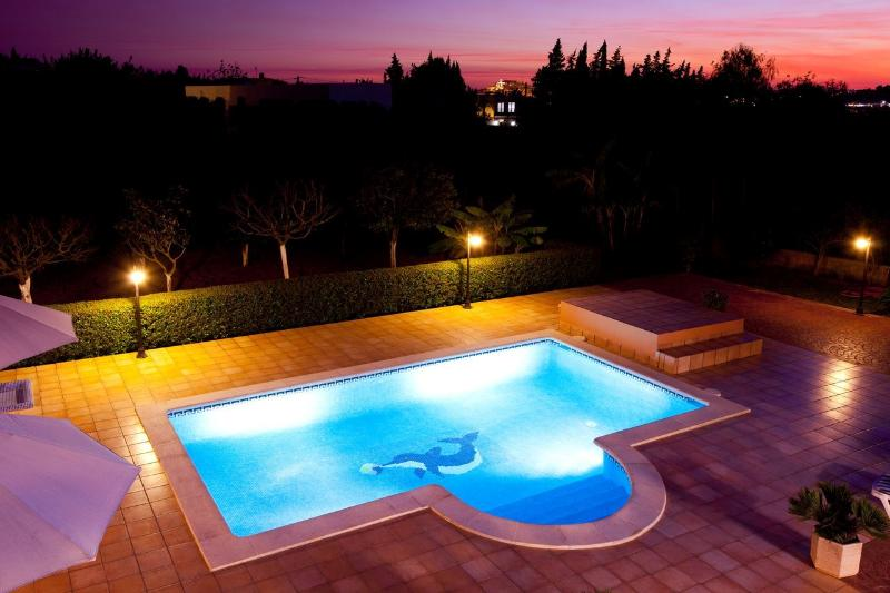 The stunning private pool area by twilight, view from the villa upstairs balcony