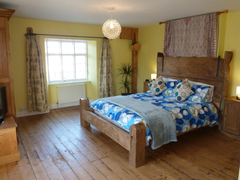 Albert Cottage, charming listed 2 bedroom character cottage.Large Bedroom with bespoke King size bed