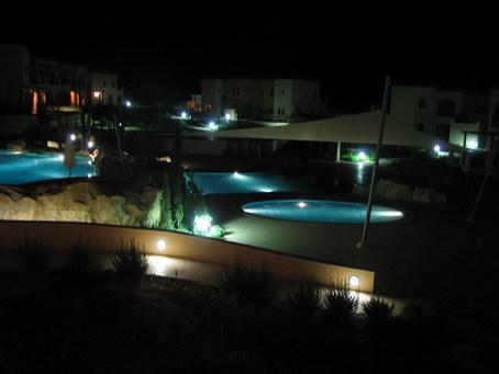 The pools illuminated at night