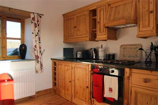 Handcrafted pine and granite kitchen