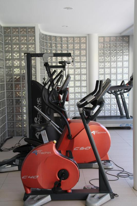 Fitness area next to indoor swimming pool