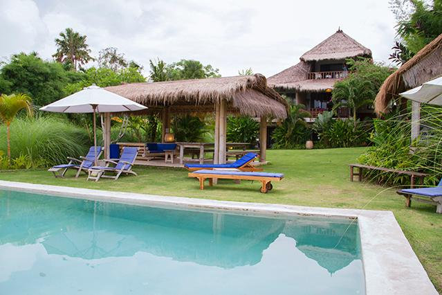 Pool area in front of the property's main building.