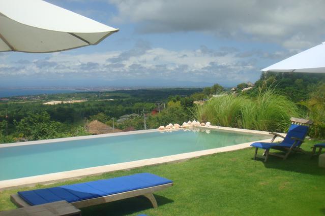 Swimming pool overlooking the island of Bali.
