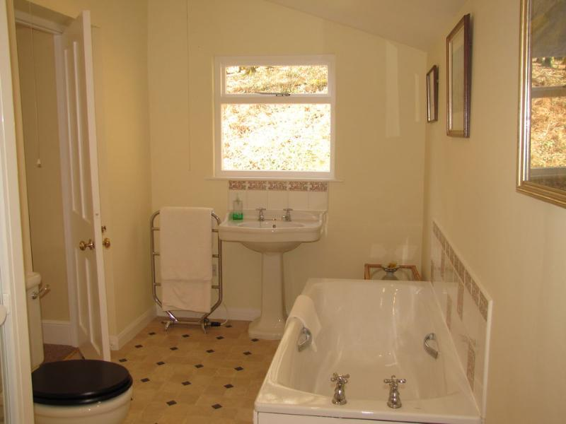 The bathroom/wc has two basins and a separate shower cubicle