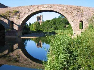 The gite is situated on the river between Lagrasse's iconic bridge and the abbey.
