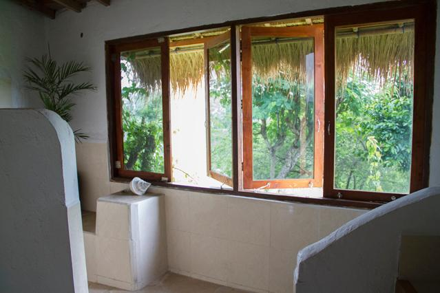 Bathroom windows overlook the uninhabited valley to the south of the property