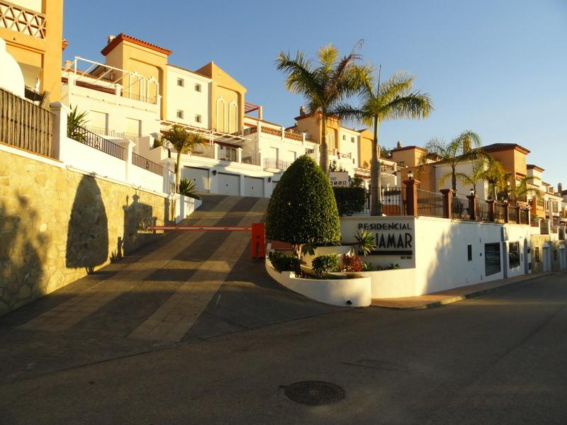 Main entrance of Residencial Aljamar - community swimming pool is to the right of the driveway