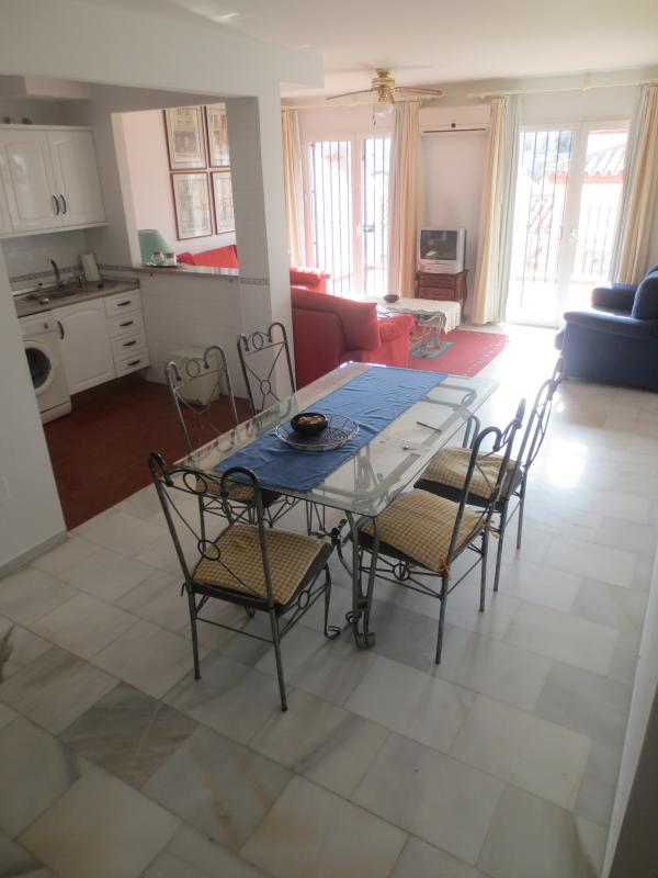 Airconditioned Dining area-leftside is the kitchen, lounge at far end with 4 patio doors to terrace