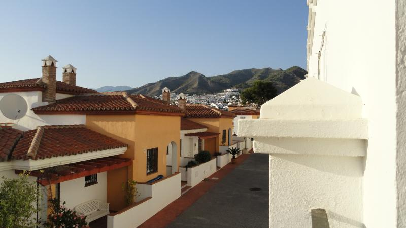 Right view from the terrace shows mountains &  the mountains & private community road below