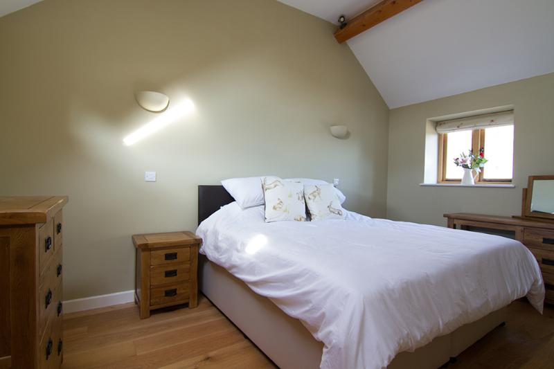 The master bedroom has a super king sized bed, large built in double wardrobe and a chest of drawers