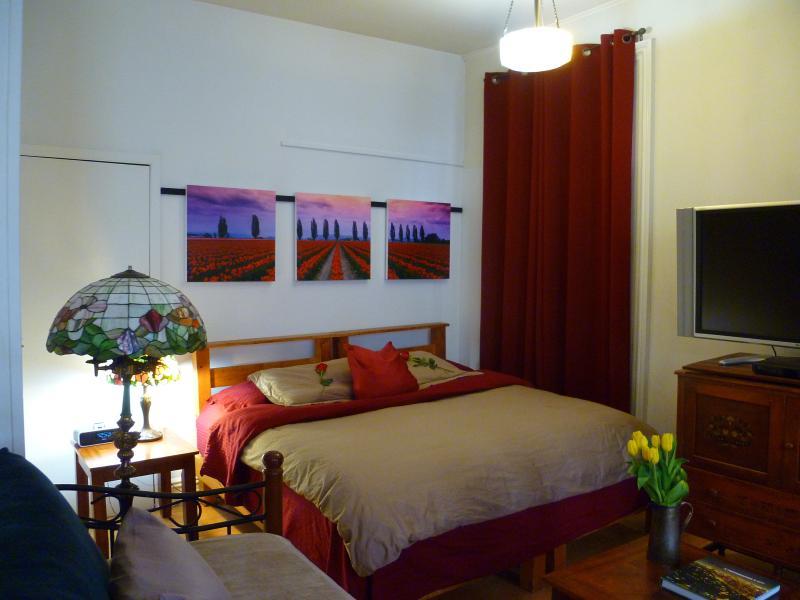 bedroom illuminated by a tiffany lamp