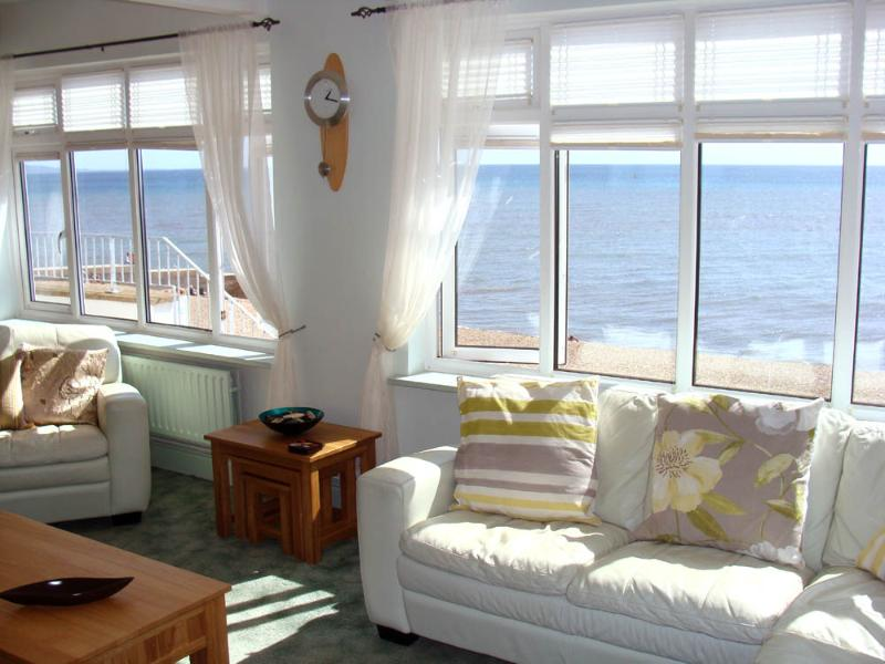 Stunning dual-aspect sea views from the Lounge with an elevated outlook accross the Cobb through to