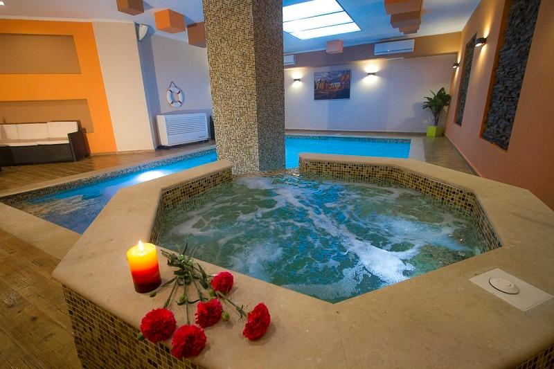 communal indoor pool area with jacuzzzi