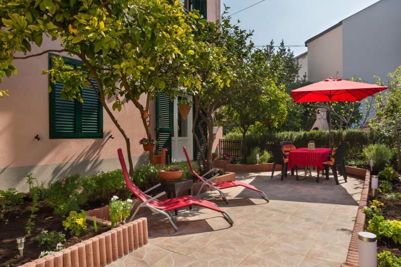 private garden with outdoor dining area and bbq staff