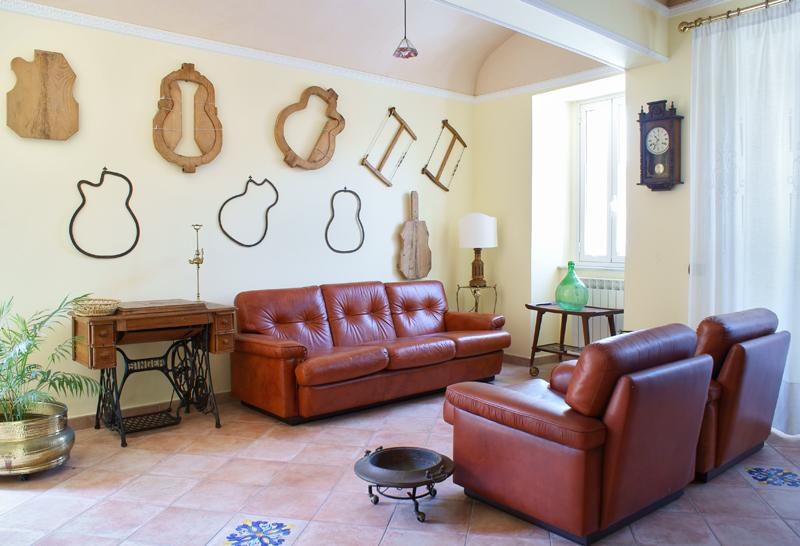 Living-room: comfortable leather sofas and plenty of light.
