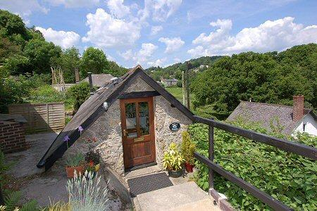 The patio at Mill Barn has beautiful views over the Wray River Valley and into the village
