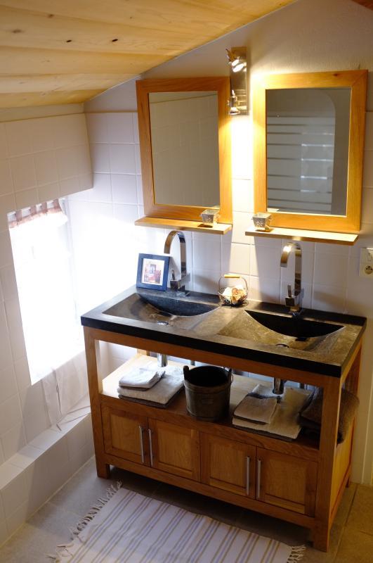 1st floor - a bathroom with a double stone basins and a bath