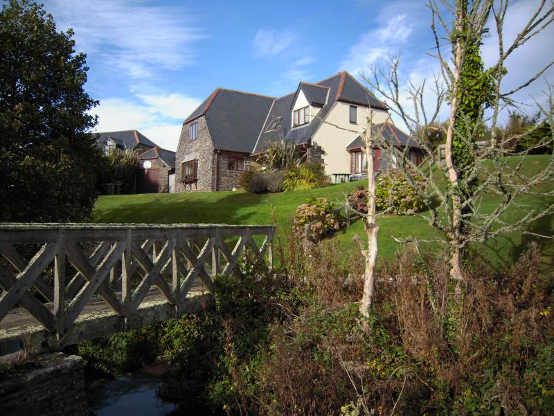 The bridge across the stream and the Puffin House